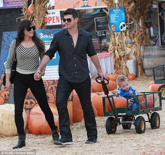 A family pic of Paula, Robin and son Julian on a trip to the pumpkin patch.