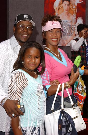 "Whitney Houston with Bobbi Kristina and Bobby Brown in 2004 at ""The Princess Diaries 2: Royal Engagement"" World Premiere"