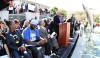 "Trayvon Martin's parents Sybrina Fulton and Tracy Martin sit while Tom Joyner gives a speech at the ""Stand Your Ground"" rally,"
