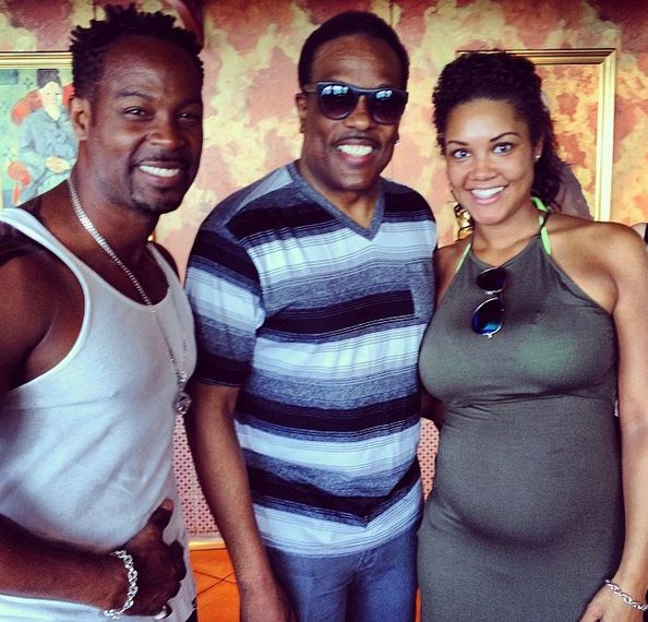 Darrin Henson and his wife snap a flick with Charlie Wilson.
