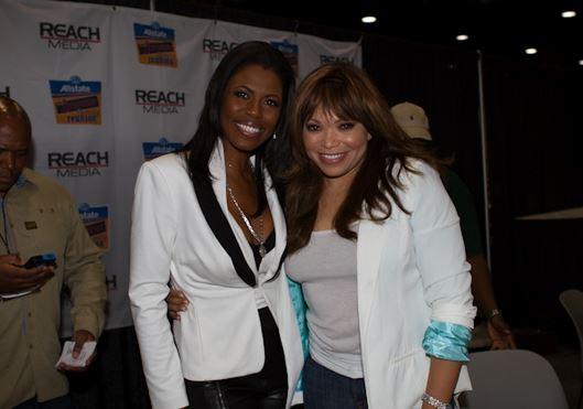 Omarosa and Tisha Campbell represent at the Allstate Tom Joyner Family Reunion.