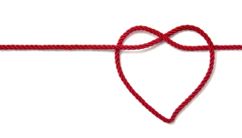 A piece of red string with a heart shape tied at the end