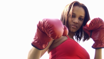 A woman wearing boxing gloves