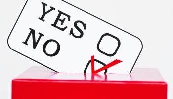 A ballot box card marked no