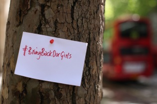 A #BringBackOurGirls note pinned to a tree