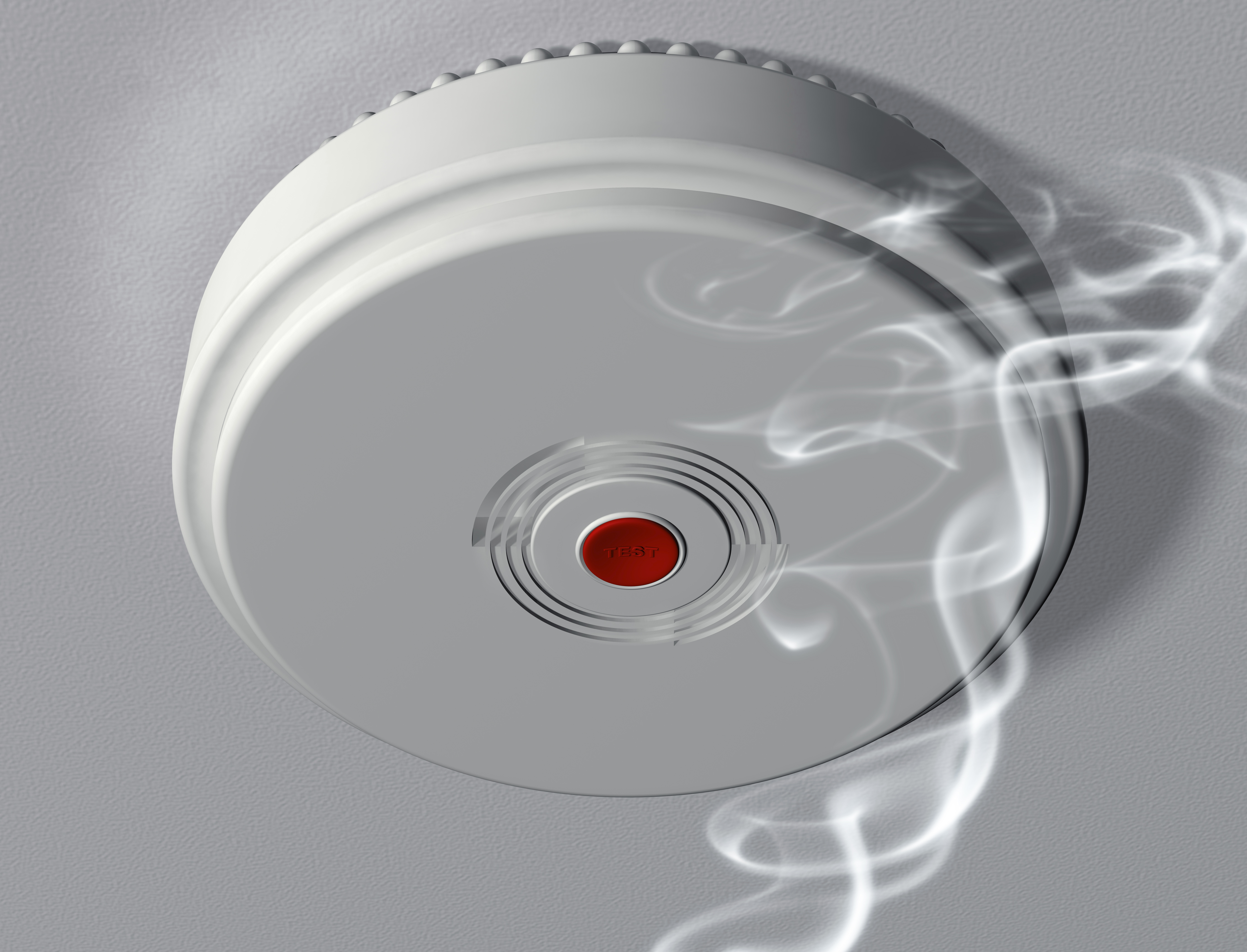 An illustration of a smoke alarm warning of a fire