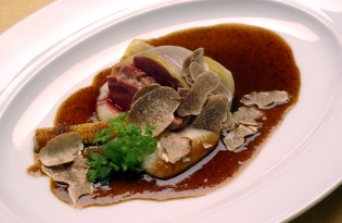 A dish of bull testicles in truffle sauce with young corn