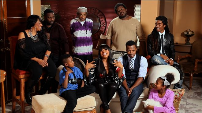 Flex Alexander, his wife Shanice and their family