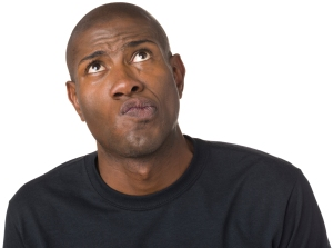 A man with a confused facial expression looking up