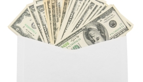 Money in an envelope on a white background