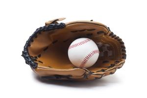 A baseball glove and ball
