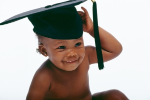A baby wearing a graduation cap