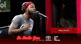Mali Music performs in the Red Velvet Cake Studios.