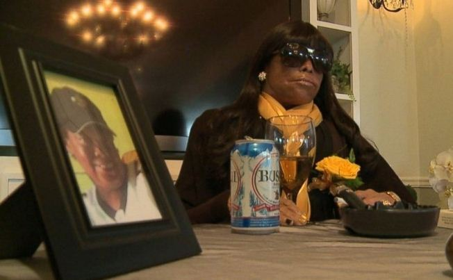 Dead Woman Propped Up With Beer In Hand At Funeral Photo