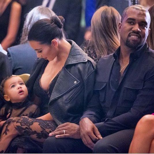 North, Kim and Kanye during Paris Fashion Week