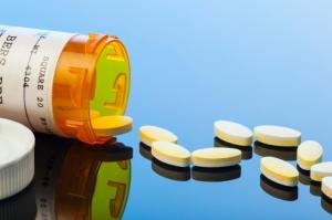 Prescription Drug Capsules Spilled on Reflective Surface