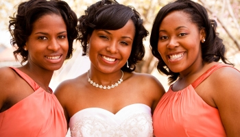 A smiling bride and her bridesmaids