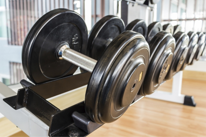 A row of black weights at a gym
