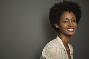 A beautiful, smiling woman with natural hair