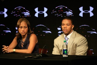 Running back Ray Rice of the Baltimore Ravens addresses a news conference with his wife Janay at the Ravens training center