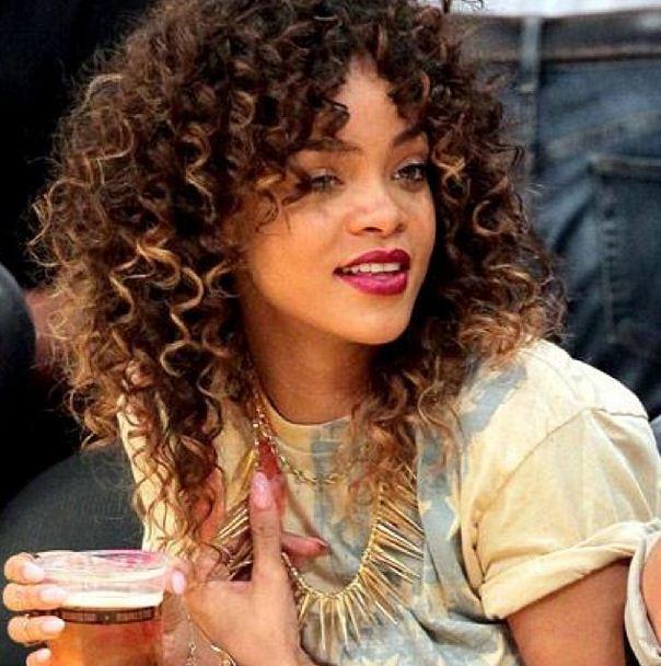 Riri with soft brown curls