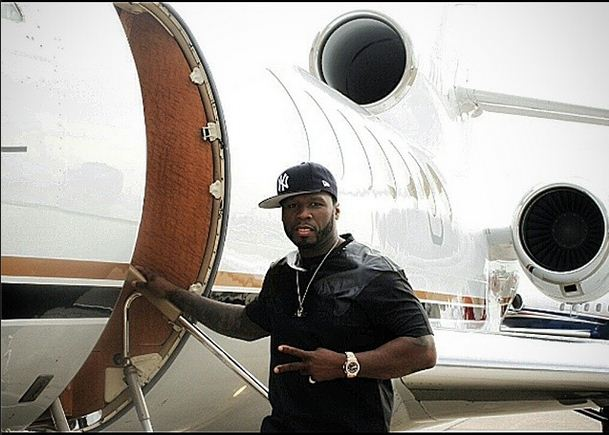 50 Cent takes a quick photo before hopping on his private jet