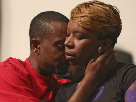 Lesley McSpadden, Mike Brown's mother and his stepfather, Louis Head, comfort each other after his death.