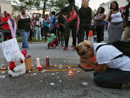 Residents of Ferguson, Missouri create a memorial where Mike Brown was killed.