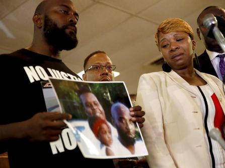 Mike Brown's mother Lesley McFadden and father, Michael Brown, Sr. at a press conference.