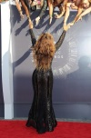 Beyonce greeting fans on the red carpet.