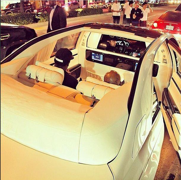 Birdman shows off in a custom convertible sports car
