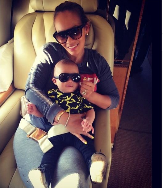 Evelyn Lozada hops on her private plane with her son Carl Jr.