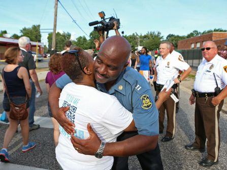 Missouri Highway Patrol captain Ron Johnson changes the police tone in Ferguson, Missouri.