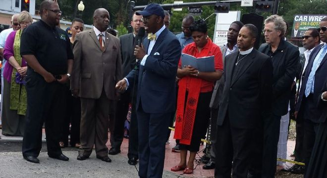 Clergy and residents gather in Ferguson.