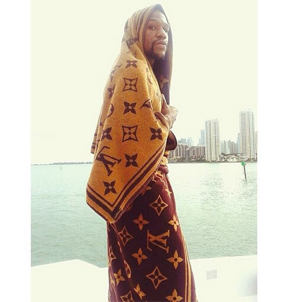 Floyd Mayweather shows off his beach style with custom Louis Vuitton towels
