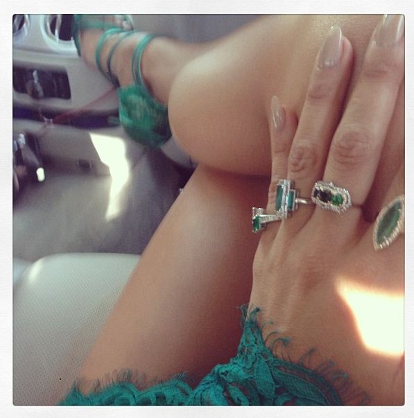 J-Lo shows off her diamond encrusted emerald jewels before heading to the Teen Choice Awards