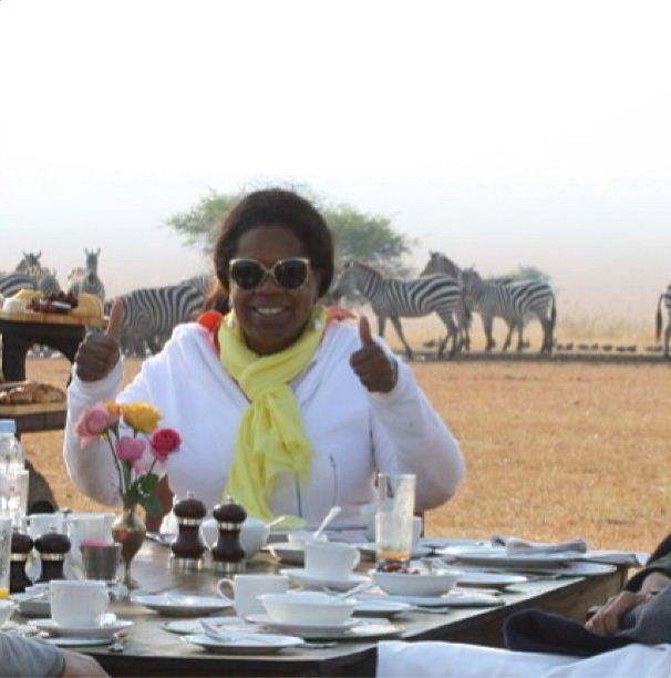 Oprah has dinner in the deserts of Ghana