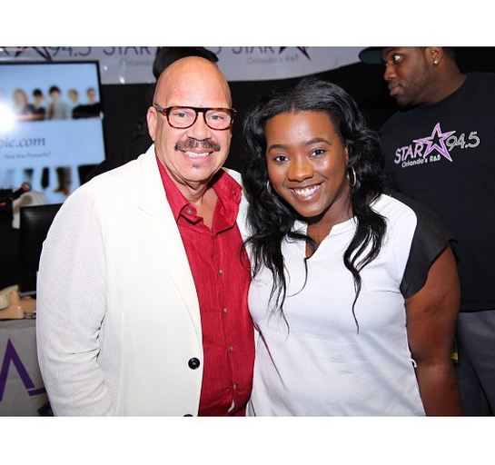Tom Joyner and a guest at the 2014 Allstate Tom Joyner Family Reunion