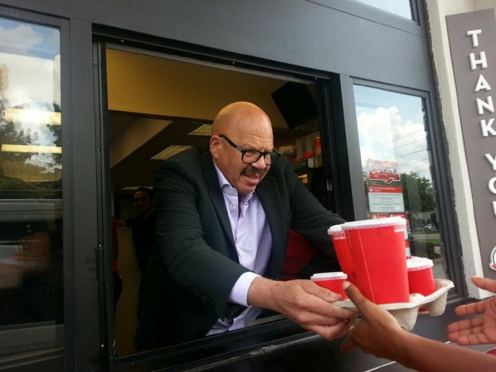 Tom Joyner hands out food at a Wendy's in New Orleans