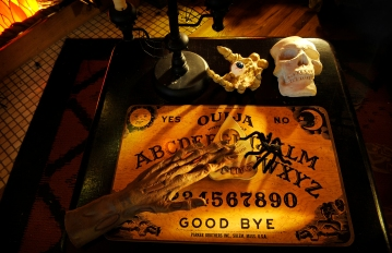 Visit to the home of Gary Alishio in Denver Friday, October 8, 2010, where he has decorated everyroom in the house for Halloween. A classic Ouija board sits out in the living room. Cyrus McCrimmon, The Denver Post