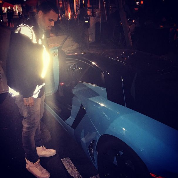 Chris Brown shows off his baby blue Lamborghini