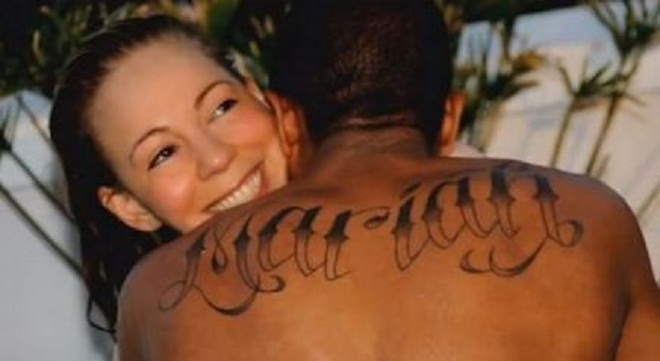 Nick Cannon got his ex-wife's name tattooed on his back.