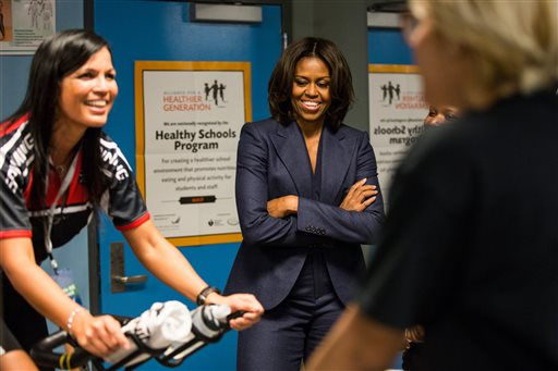 First Lady Michelle Obama says that she likes to click through design & food shows.