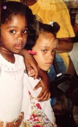 Rihanna as a kid rocking the barrettes