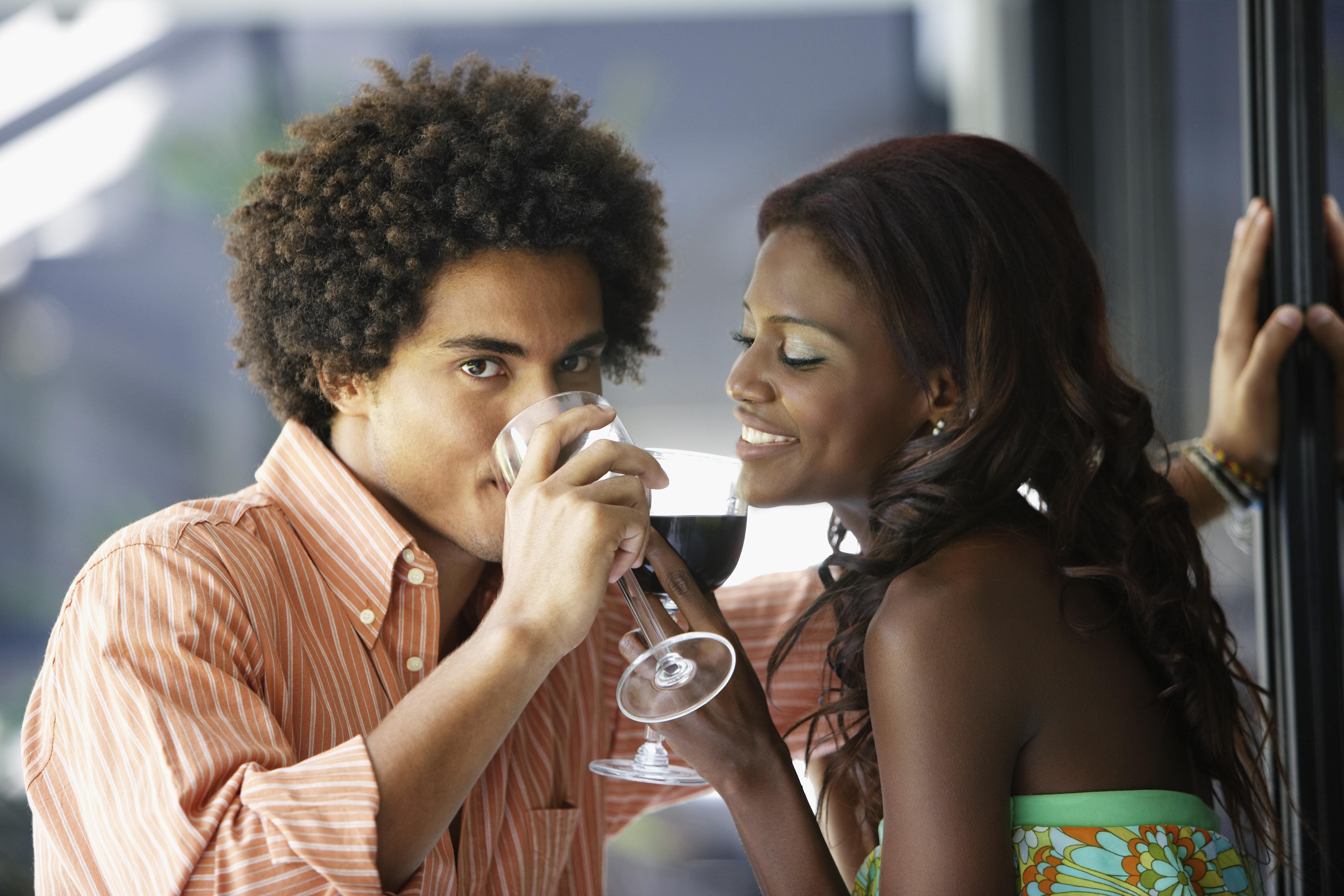 South American couple drinking wine