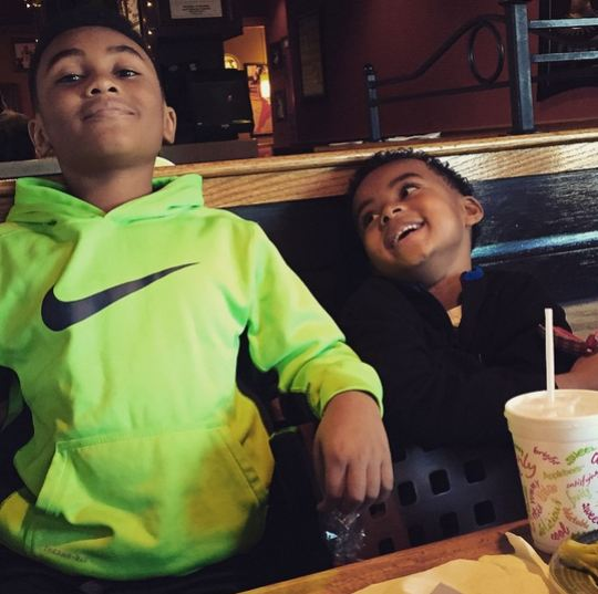 Brotherly love: Khalil and Peyton get silly in a restaurant.
