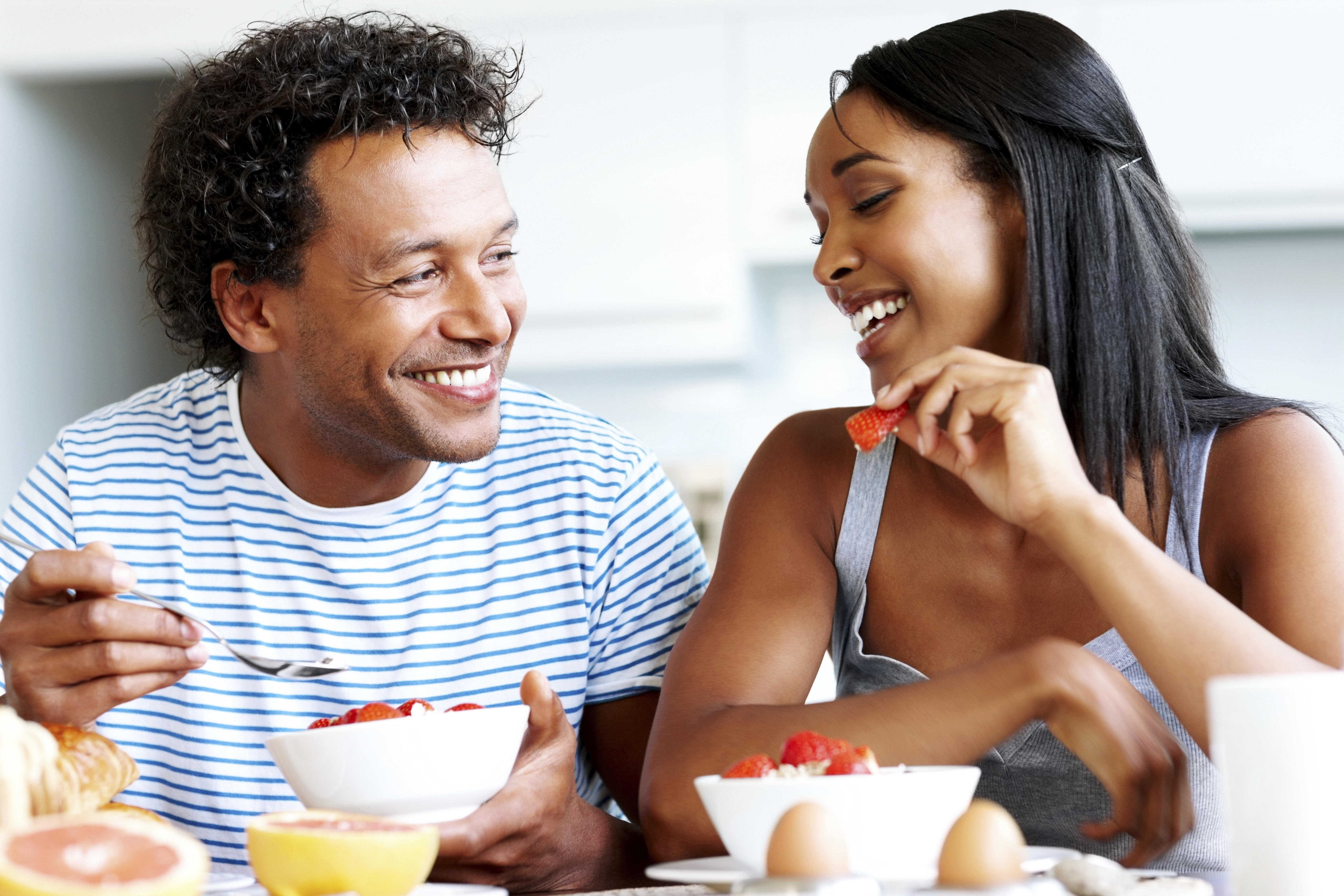 Happy couple having casual chat at breakfast table