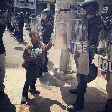BaltimoreBoyHandsWaterToPolice