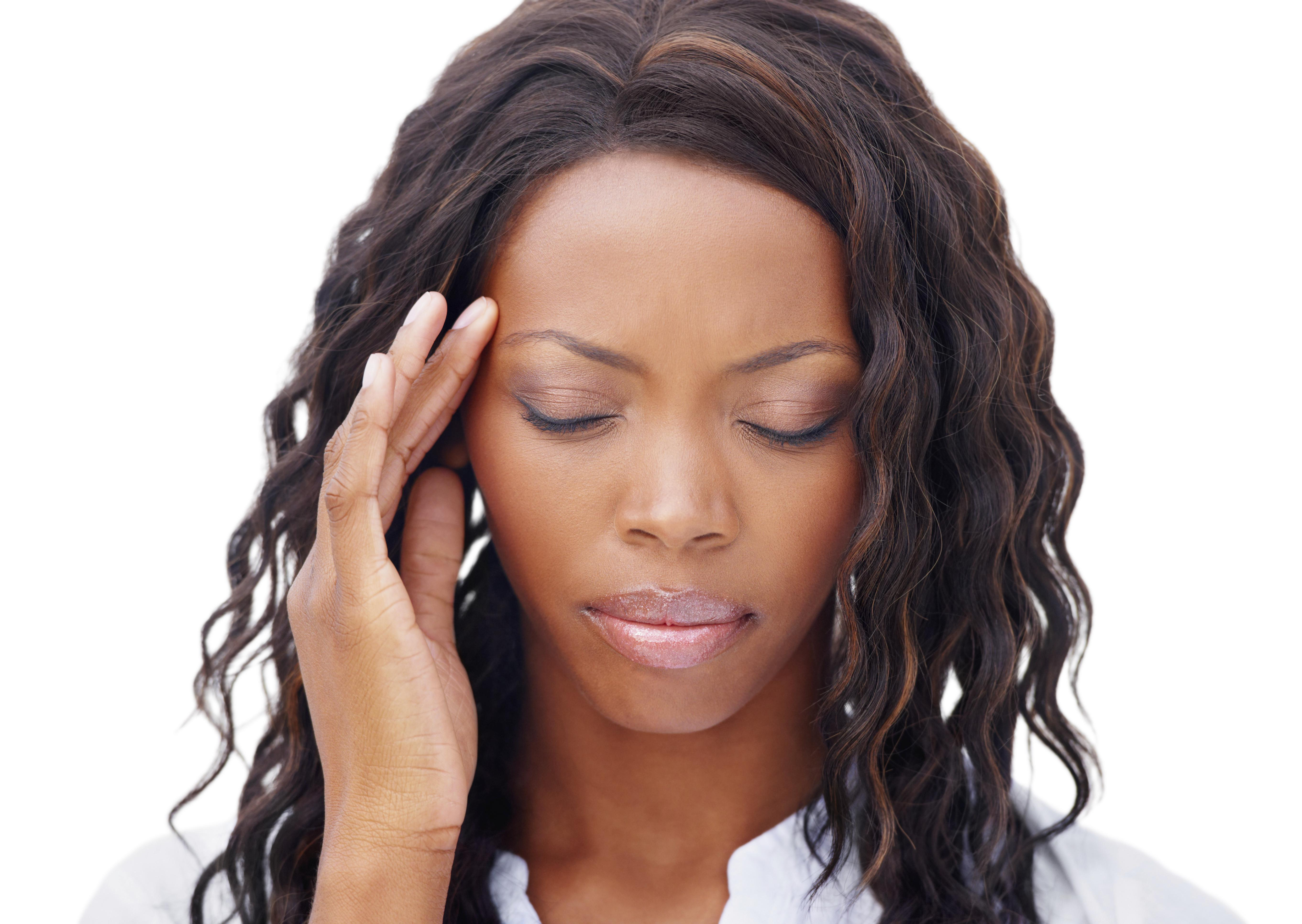 Cropped view of a pretty african american woman with a migraine