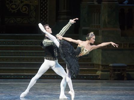 """This photo provided by American Ballet Theater, Misty Copeland and James Whiteside appear in """"Swan Lake"""" at the Metropolitan Opera House on June 24, 2015. It was Copeland's New York debut in the lead role, a key moment for her fans who hope she'll soon be named American Ballet Theater's first black principal dancer. (Gene Schiavone/American Ballet Theater via AP)"""